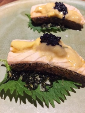 Perfectly torched salmon with uni, caviar, nori, and shiso (Source: @micca.dj Instagram)