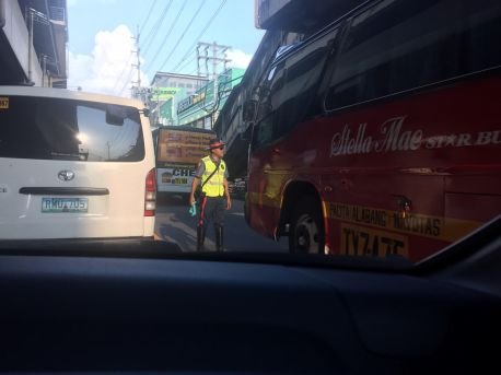 An HPG officer making sure buses stay in their lanes at EDSA-Balintawak (Source: miccadj)